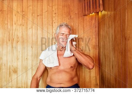 Senior man sweats in the steam room or sauna at the Wellness Hotel