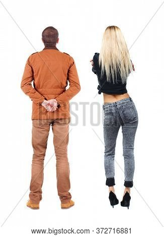 Back view of couple in winter jacket. beautiful friendly girl and guy together. Rear view people collection. backside view of person. Isolated over white background.