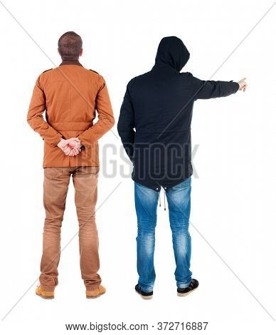 Back view of couple couple in winter jackets pointing. beautiful friendly girl and guy together. Rear view people collection. backside view of person. Isolated over white background.
