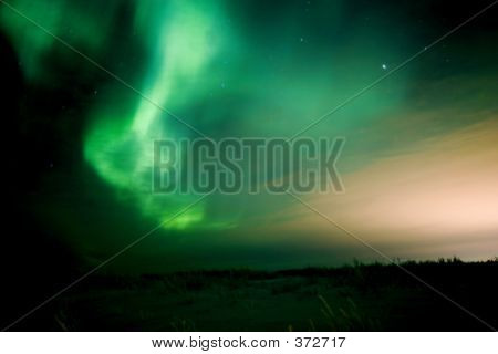 Aurora And Town Lights