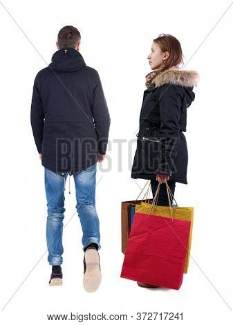 back view of couple with shopping bags in winter jacket. backside view of person. Rear view people collection. Isolated over white background.