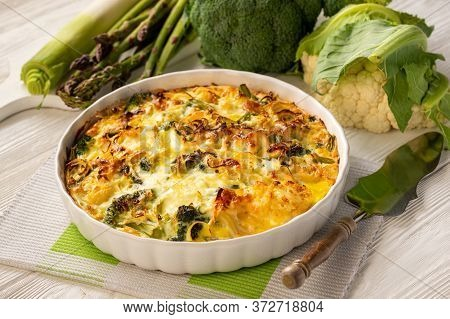 Broccoli, Cauliflower And Asparagus Casserole With Eggs And Cheese, Keto Diet Dish.