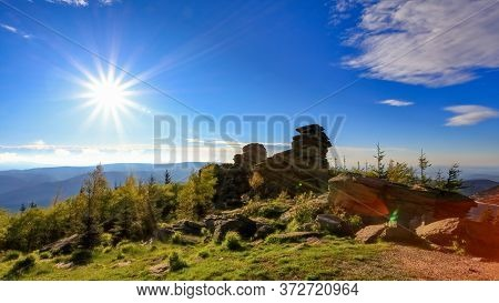 Prominent Rock Formations In Mountains Forest With Sun Rays During Sunset, Obri Skaly, Jeseniky, Cze