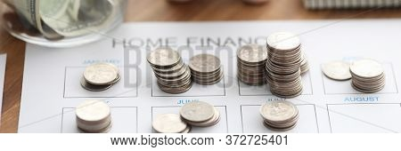 Coins And Piggy Bank Lie On Home Finance Form. Records Income And Expenses. Using Budget To Plan Sav