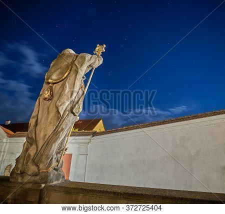 Historical Christian Statue From The Back With Night Sky With Stars In The Background, Broumov, Czec