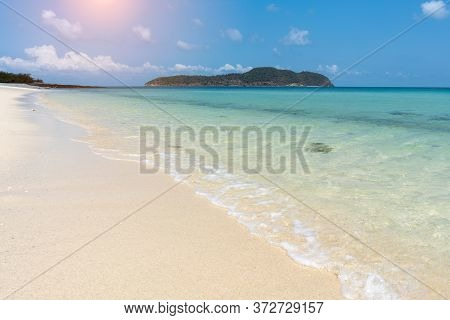 The Sand Beach On Sunny Day With The Beautiful Sea Water On Holiday Time Concept Summer On The Beach
