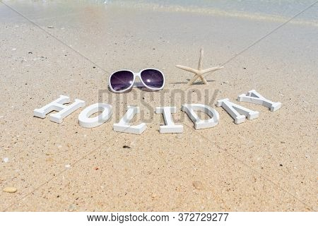 Sunglasses And Starfish On The Sand Beach On Sunny Day With The Beautiful Sea Water On Holiday Time