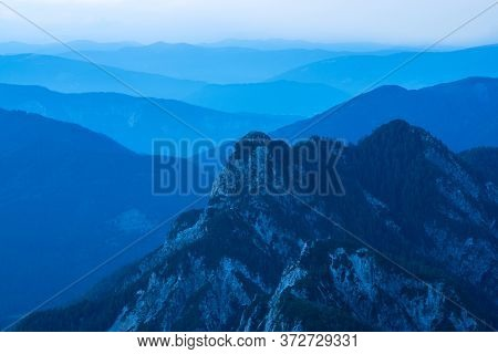 Spectacular View Of Blue Mountain Ranges Silhouettes And Fog In Valleys. Julian Alps, Triglav Nation