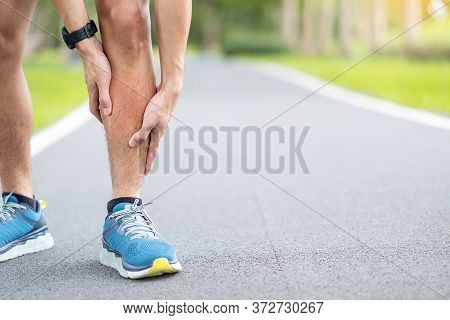 Young Adult Male With His Muscle Pain During Running. Runner Man Having Leg Ache Due To Shin Splints