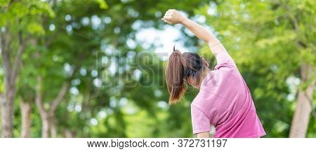 Young Adult Female In Pink Sportswear Stretching Muscle In The Park Outdoor, Runner Woman Warm Up Re