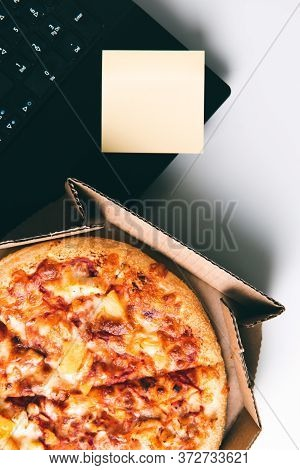 Pizza In Box, Laptop And Empty Sticker With Copy Space On Desk In Office. Concept Of Food Or Pizza D