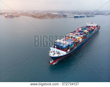 Aerial Of Cargo Ship Carrying Container And Running For Export And Import Goods  From  Cargo Yard Po