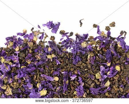 Tie Guan Yin Tea With Mallow Flowers, Isolated On White Background. Organic Tea. Top View. Close Up.