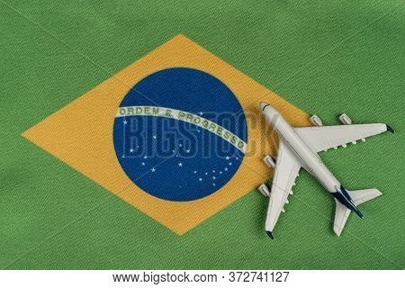 Flag Of Federative Republic Of Brazil And Model Airplane. Opening Borders After Quarantine. Mesatlan