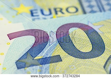 Macro Shot Of A European Union Banknote Of 20 Eur, Close-up Of The Number Twenty.