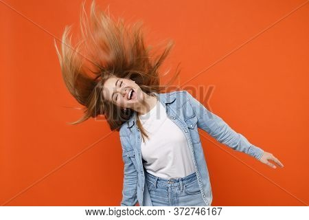 Cheerful Young Woman Girl In Casual Denim Clothes Posing Isolated On Orange Wall Background Studio P