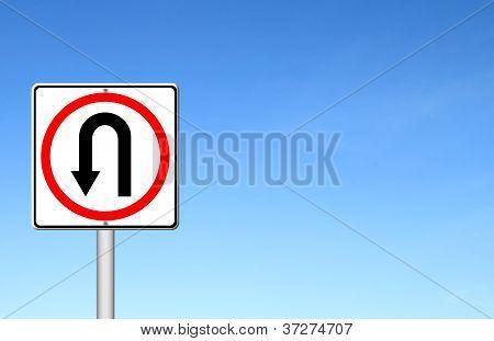 Turn Back Road Sign Over Blue Sky