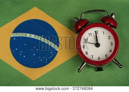 Brazil Flag And Vintage Alarm Clock. Time To Travel To Brazil.
