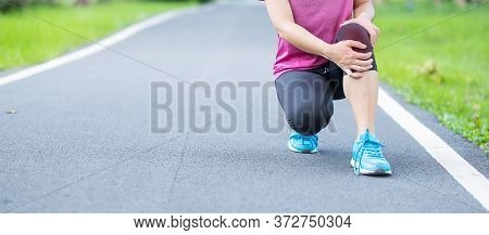 Young Adult Female With Muscle Pain During Running. Runner Have Ache Due To Runners Knee Or Patellof