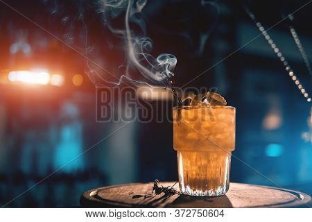 Scottish Bee Cocktail With Smoke On Blue Background