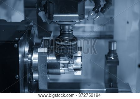 The 4-axis Cnc Milling Machine Cutting The Automotive Parts By Face Milling Tools. The Hi-precision