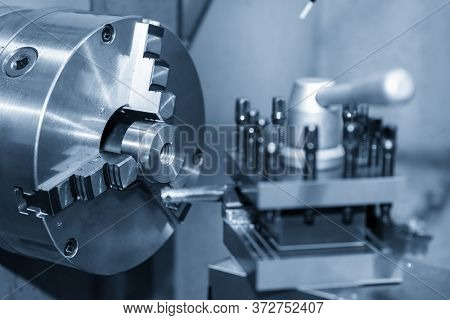 The Operation Of Lathe Machine Cutting The Metal Parts With The Cutting Tools. The Metalworking Proc