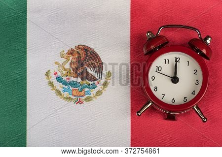 Mexico Flag And Vintage Alarm Clock. Time To Travel To Mexico.