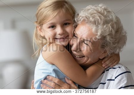 Closeup Image Happy Granddaughter Hugging With Caring Old Grandmother