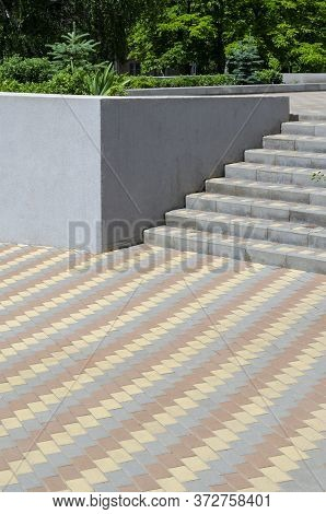 The Platform And Steps Are Covered With Three-color Paving Slabs.
