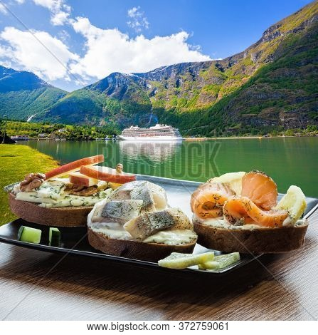 Typical Scandinavian Sandwiches Against Cruise Ship In The Port Of Famous Flam, Norway