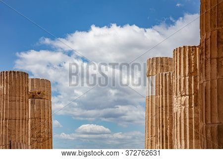 Athens, Greece. Propylaea Columns In The Acropolis, Blue Cloudy Sky In Spring Sunny Day.