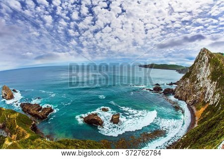 The picturesque coast of the Pacific Ocean near Nugget Points. Big stones - rocks along the shore. Photo taken by Fisheye lens. New Zealand. The concept of active, environmental and photo tourism