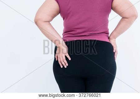 The Back Of A Fat Woman Which Puts The Left Hand On The Hips Which Is Large And Full Of Excess Fat O