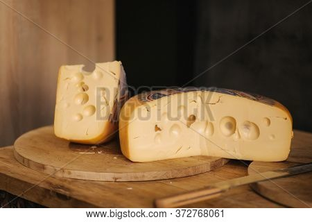 Cheese Maasdam Om Wooden Board With Knife For Cheese