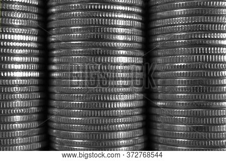 Wall Of Stacks And Edges Of Nickel Coins. Bleached Monochrome Dark Background Or Wallpaper On An Eco