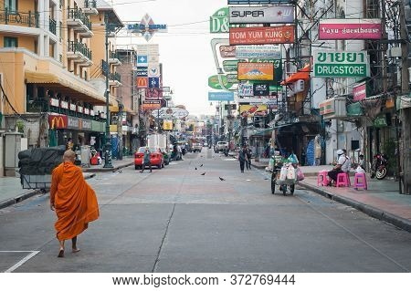 Bangkok, Thailand - 29. May 2018. An Unknown Buddhist Monk Walks Barefoot Down The City Street. Khao