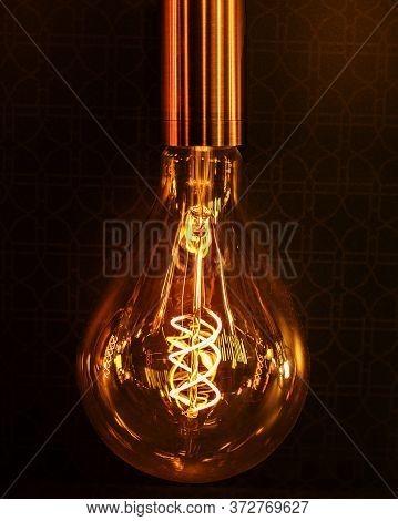 Lighting Decor. Retro Light Bulb Filament Close Up.illuminated.