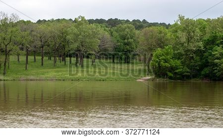 A Small Walkway Is Seen At The Edge Of The Waters Of Tranquil And Peaceful Lake Eucha In Oklahoma Wi