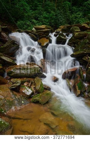 Waterfall Pouring Over Rocks In Pisgah National Forest, Nc.