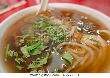 Taiwanese snacks of thickened soup noodles with starch coated pork
