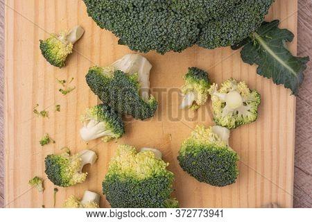 Fresh Green Broccoli On A Wooden Cutting Board. Macro Photo Green Fresh Vegetable Broccoli. Green Ve