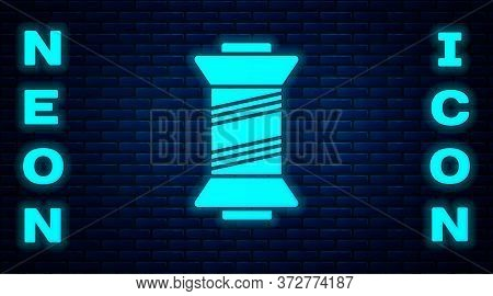 Glowing Neon Sewing Thread On Spool Icon Isolated On Brick Wall Background. Yarn Spool. Thread Bobbi