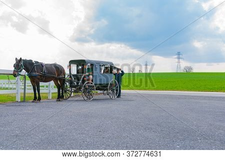 Lancaster Usa - October 22 2014; Beautiful Green Fields Of Surrounding County Farmland With Amish Ho