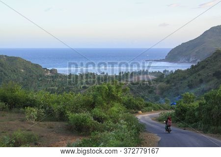 Scooter On Road To Mawun Beach, Lombok, Indonesia. Kuta Lombok Is An Exotic Paradise On The Indonesi