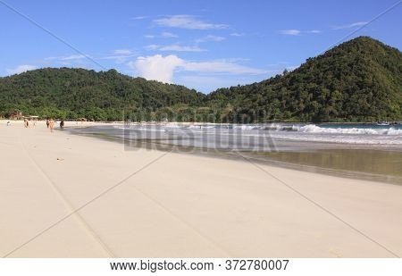 People, White Sand And Waves At Mawun Beach Lombok. Kuta Lombok Is An Exotic Paradise On The Indones