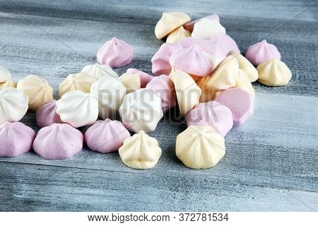 Meringue. Crispy White And Pink Twisted Meringue. Concept Love Of Sweet On Table