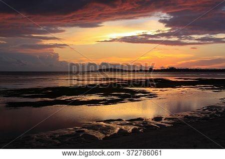 Scenic Sunset From Pantai Sejuk Pundewa Beach View Of Gili Islands Silhouette. Exotic Tropical Desti