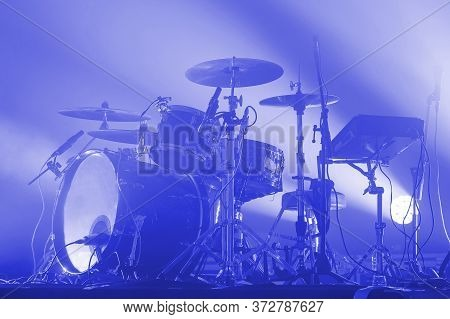 Modern Drum Set Of A Rock Band On Stage In Blue Light