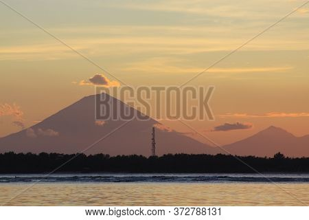 Agung Volcano From Bali, With Clouds Seen In The Distance At Sunset, From Gili Air Island, Lombok, I