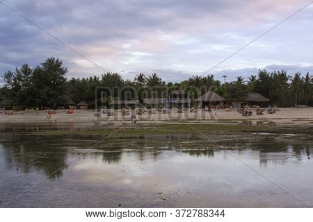 Cloudy Day On Beach With Few Tourists At Low Tide, On Gili Air Island, Lombok, Indonesia
